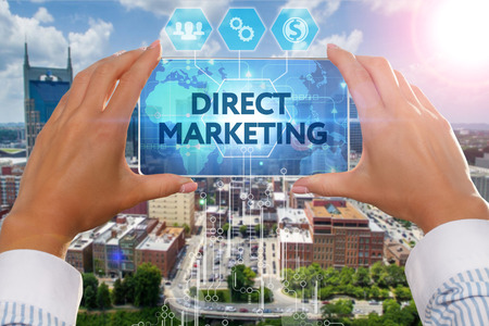 direct marketing: The girl looks at a virtual screen of Smartphone and see the inscription : Direct marketing