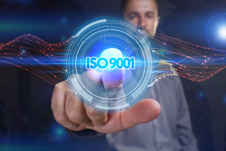 Business, Technology, Internet and network concept. Young business man chooses the virtual screen: ISO 9001