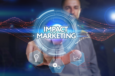 Business, Technology, Internet and network concept. Young business man chooses the virtual screen: impact marketing