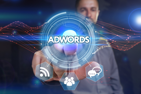 adwords: Business, Technology, Internet and network concept. Young business man chooses the virtual screen: AdWords