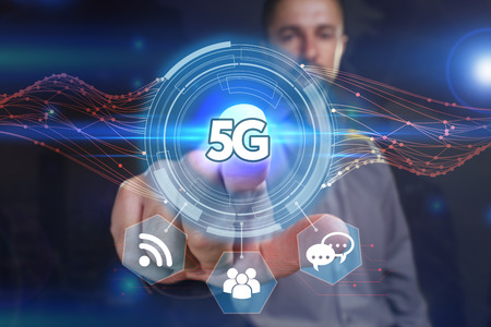 Business, Technology, Internet and network concept. Young business man chooses the virtual screen: 5G Stock Photo