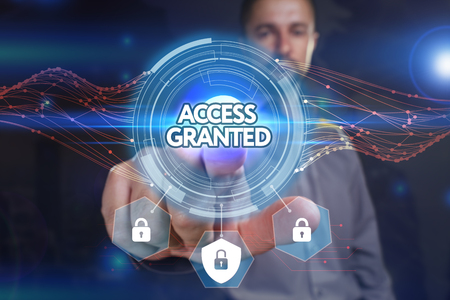 access granted: Business, Technology, Internet and network concept. Young businessman, select on the virtual display: Access granted Stock Photo