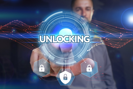 unlocking: Business, Technology, Internet and network concept. Young businessman, select on the virtual display: Unlocking