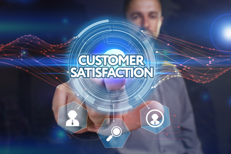 Business, Technology, Internet and network concept. Young businessman, select on the virtual display: customer satisfaction