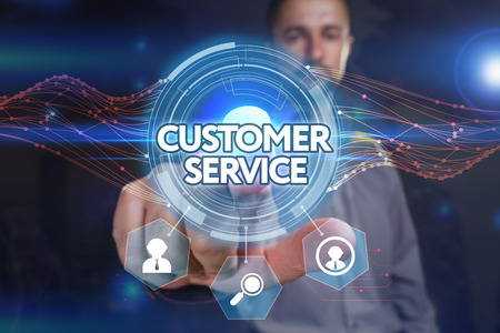 domain: Business, Technology, Internet and network concept. Young businessman, select on the virtual display: customer service