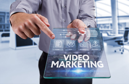 Business, Technology, Internet and network concept . Young business man working on the tablet of the future , select the virtual screen : Video marketing
