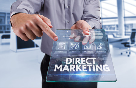 direct marketing: Business, Technology, Internet and network concept . Young business man working on the tablet of the future , select the virtual screen : Direct marketing Stock Photo