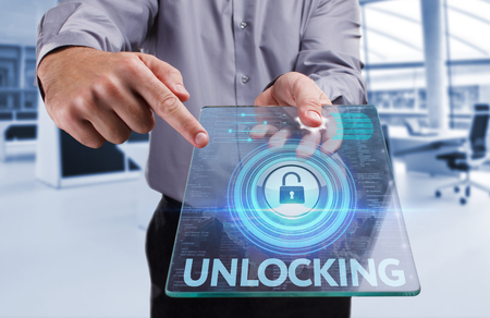 unlocking: Business, Technology, Internet and network concept . Young business man working on the tablet of the future , select the virtual screen : Unlocking Stock Photo