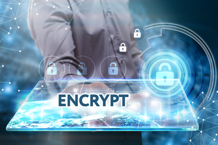 encrypt: Business, Technology, Internet and network concept. Young businessman working on a tablet of the future, he sees the inscription: encrypt