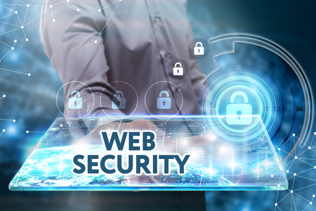 web security: Business, Technology, Internet and network concept. Young businessman working on a tablet of the future, he sees the inscription: Web security Stock Photo