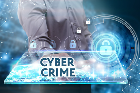 control fraud: Business, Technology, Internet and network concept. Young businessman working on a tablet of the future, he sees the inscription: Cyber crime