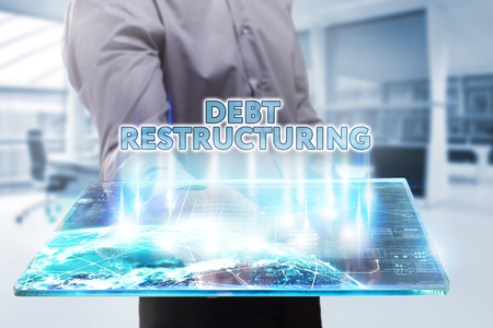 restructuring: Business, Technology, Internet and network concept. Young businessman working on a tablet of the future, he sees the inscription: debt restructuring