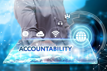 accountability: Business, Technology, Internet and network concept. Young businessman working on a tablet of the future, he sees the inscription: accountability Stock Photo