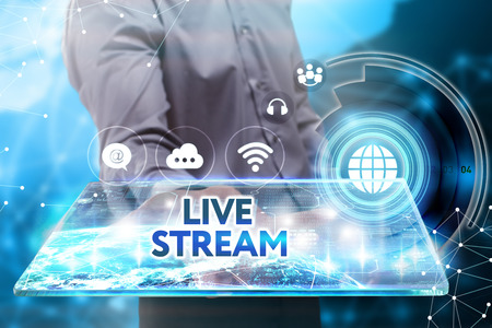 live stream: Business, Technology, Internet and network concept. Young businessman working on a tablet of the future, he sees the inscription: live stream