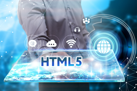 html5: Business, Technology, Internet and network concept. Young businessman working on a tablet of the future, he sees the inscription: HTML5