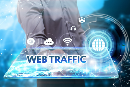 web traffic: Business, Technology, Internet and network concept. Young businessman working on a tablet of the future, he sees the inscription: web traffic