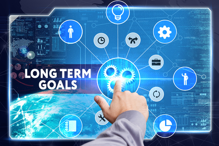long term: Business, Technology, Internet and network concept. Young businessman working on a virtual screen: long term goals