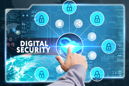 cyber defence: Business, Technology, Internet and network concept. Young businessman working on a virtual screen of the future and sees the inscription: Digital security
