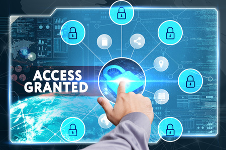 access granted: Business, Technology, Internet and network concept. Young businessman working on a virtual screen of the future and sees the inscription: Access granted