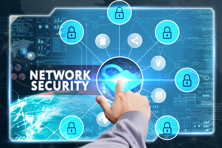 cyber defence: Business, Technology, Internet and network concept. Young businessman working on a virtual screen of the future and sees the inscription: Network security