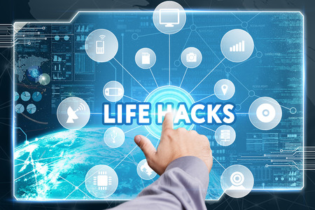 easier: Business, Technology, Internet and network concept. Young businessman working on a virtual screen of the future and sees the inscription: Life Hacks