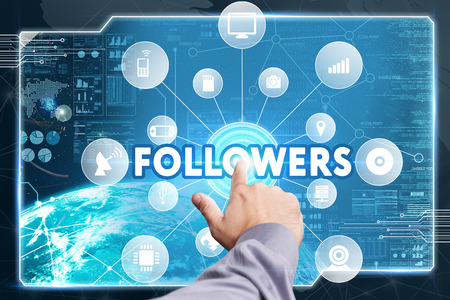 followers: Business, Technology, Internet and network concept. Young businessman working on a virtual screen of the future and sees the inscription: Followers