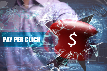 Business, Technology, Internet and network concept. Young businessman breaks the virtual future of the screen on which the inscription: pay per click