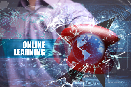 Business, Technology, Internet and network concept. Young businessman breaks the virtual future of the screen on which the inscription: online learning Stock Photo - 65554761