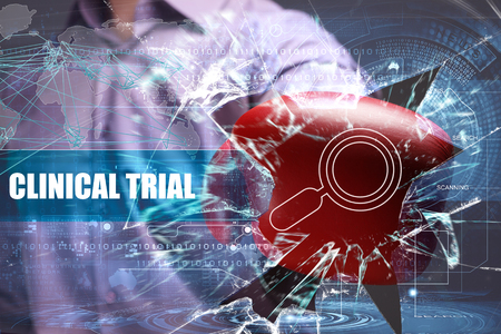 clinical trial: Business, Technology, Internet and network concept. Young businessman breaks the virtual future of the screen on which the inscription: clinical trial