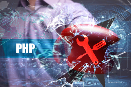 Business, Technology, Internet and network concept. Young businessman breaks the virtual future of the screen on which the inscription: PHP