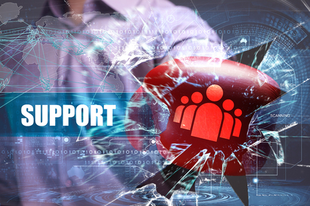 Business, Technology, Internet and network concept. Young businessman breaks the virtual future of the screen on which the inscription: support