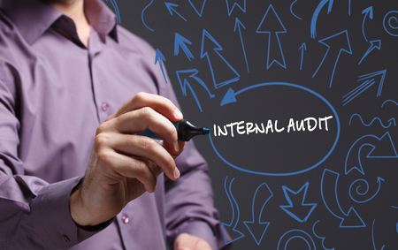 internal audit: Technology, internet, business and marketing. Young business man writing word: internal audit Stock Photo