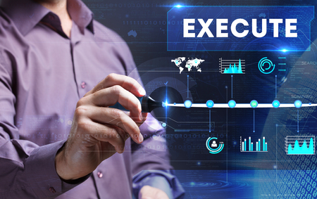 execute: Technology, internet, business and marketing. Young business man writing word: Execute Stock Photo