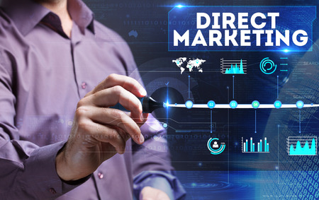 Technology, internet, business and marketing. Young business man writing word: Direct marketing Stock Photo