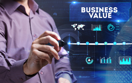 Technology, internet, business and marketing. Young business man writing word: business value