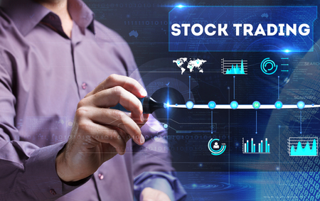 Technology, Internet, business and marketing. Young business person sees the word: stock trading