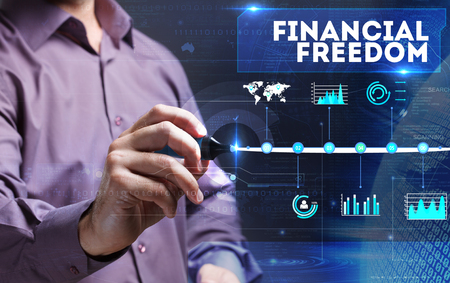 financial freedom: Technology, Internet, business and marketing. Young business person sees the word: financial freedom