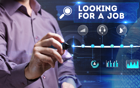 looking for job: Technology, Internet, business and marketing. Young business person sees the word: looking for a job