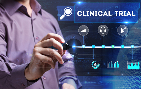 clinical trial: Technology, Internet, business and marketing. Young business person sees the word: clinical trial