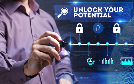 Technology, Internet, business and marketing. Young business person sees the word: unlock your potential