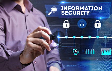 background information: Technology, Internet, business and marketing. Young business person sees the word: Information security Stock Photo