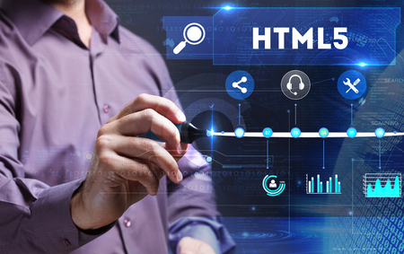 html5: Technology, Internet, business and marketing. Young business person sees the word: HTML5