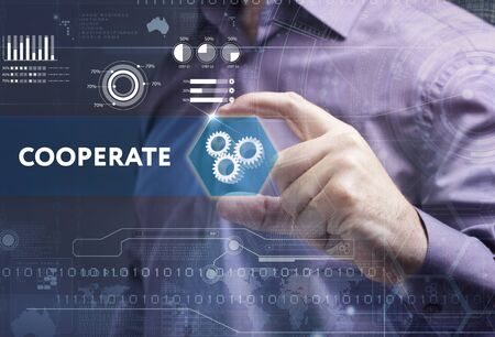 cooperate: Business, Technology, Internet and network concept. Young businessman working on a virtual screen of the future and sees the inscription: cooperate Stock Photo