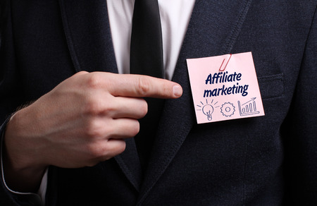 affiliate marketing: Business, Technology, Internet and network concept. Young businessman shows the word: Affiliate marketing