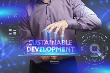 desarrollo sostenible: Business, Technology, Internet and network concept. Young businessman shows the word on the virtual display of the future: Sustainable development Foto de archivo