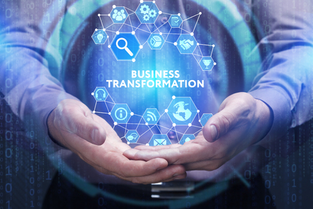Business, Technology, Internet and network concept. Young businessman shows the word on the virtual display of the future: Business transformation