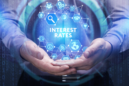 interest rates: Business, Technology, Internet and network concept. Young businessman shows the word on the virtual display of the future: Interest rates