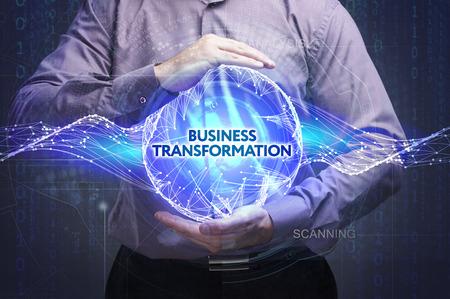 비즈니스, 기술, 인터넷 및 네트워크 개념. 젊은 사업가 단어를 보여줍니다 : 비즈니스 변환 스톡 콘텐츠
