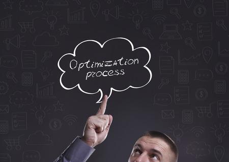 businessman thinking: Business, Technology, Internet and marketing. Young businessman thinking about: Optimization process Stock Photo
