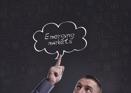 emerging markets: Business, Technology, Internet and marketing. Young businessman thinking about: Emerging markets